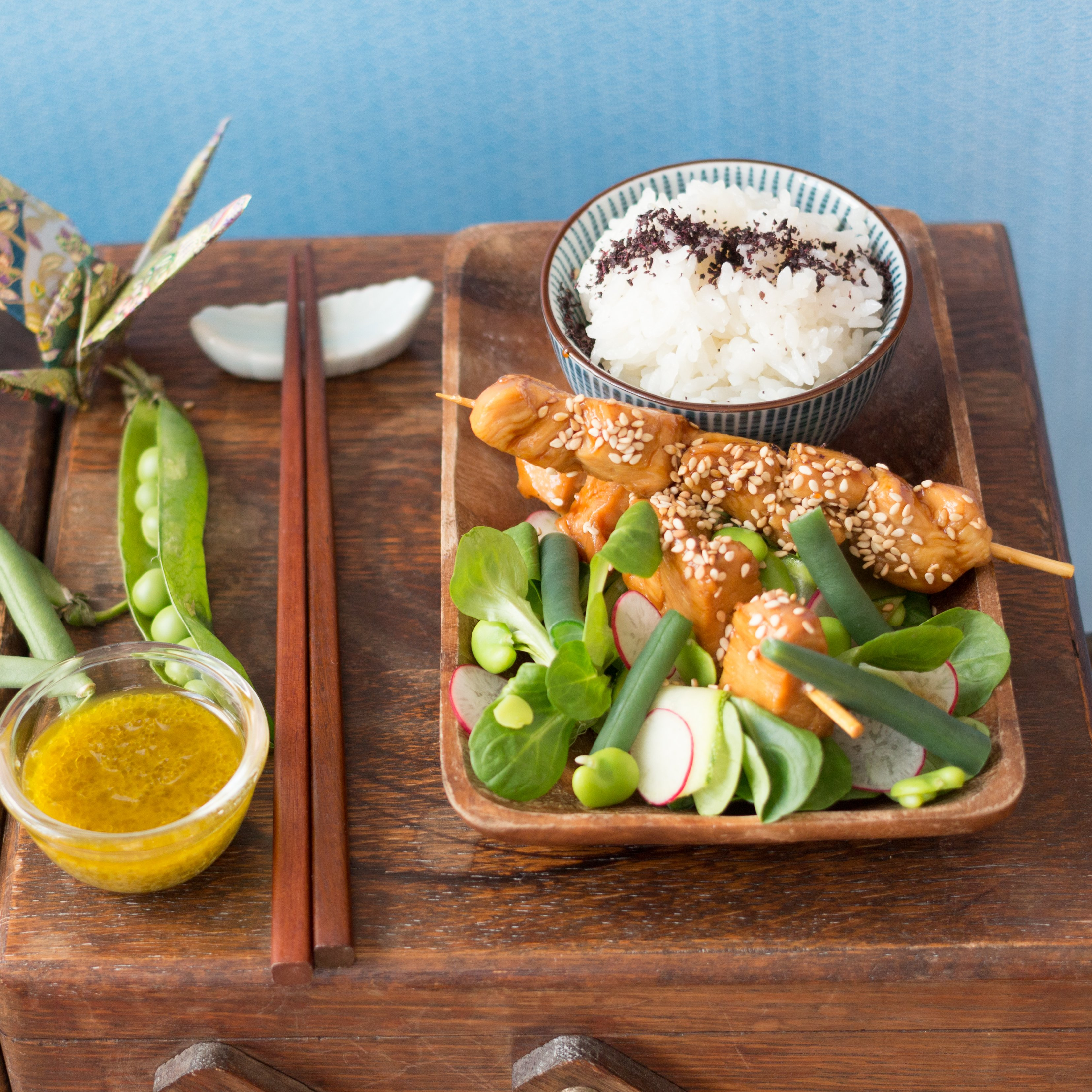 Teriyaki chicken skewers and salad with a yuzu kosho vinaigrette